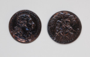 Two tokens with the head of David Garrick