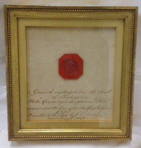 Red wax seal of Garrick contemplating the bust of Shakespeare