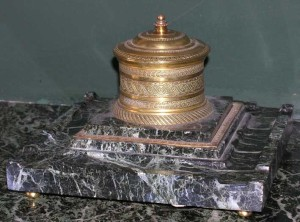 A brass and marble ash tray