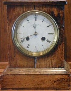 A wooden cased mantel clock