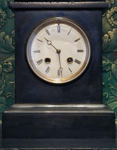 A slate cased mantel clock