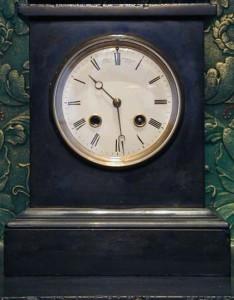 A slate cased mantel clock