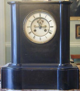 A black marble mantel clock